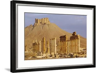 Syria, Palmyra, Column Ruins with Qalaat Ibn Maan Castle in Background--Framed Giclee Print