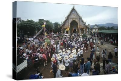 Thailand, Tha Thon, Crowd at Feast of Offerings, Outside Temple--Stretched Canvas Print