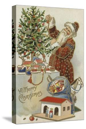 Father Christmas Decorating a Christmas Tree--Stretched Canvas Print