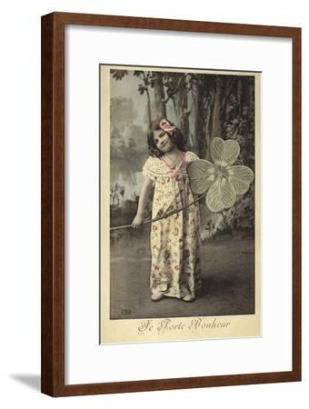Young Girl Holding Giant Four-Leaf Clover--Framed Photographic Print