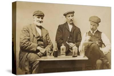 Three Working Men Enjoying a Drink--Stretched Canvas Print