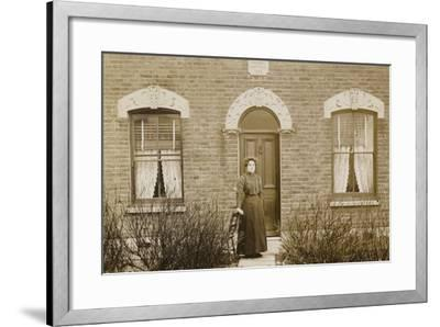 Woman Standing Outside Reuben Cottage--Framed Photographic Print