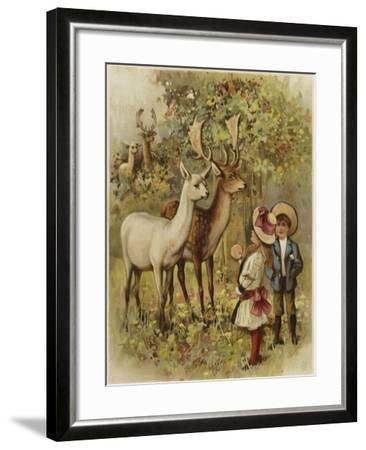 Two Young Children Feeding the Deer in a Park--Framed Giclee Print