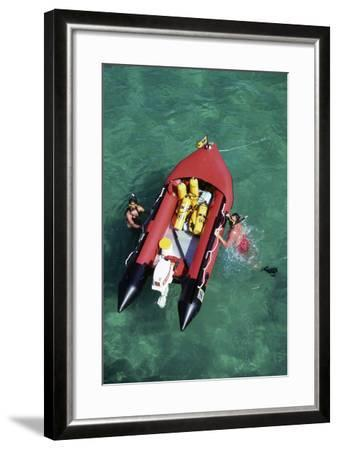 Couple Snorkeling Off their Dinghy in Biscayne Bay, C.1990--Framed Photographic Print
