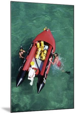 Couple Snorkeling Off their Dinghy in Biscayne Bay, C.1990--Mounted Photographic Print