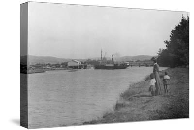 Woman and Children Watching a Ship at Waipu Wharf, C.1900--Stretched Canvas Print