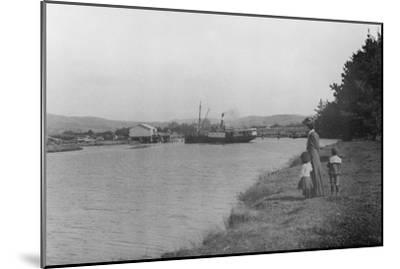 Woman and Children Watching a Ship at Waipu Wharf, C.1900--Mounted Photographic Print