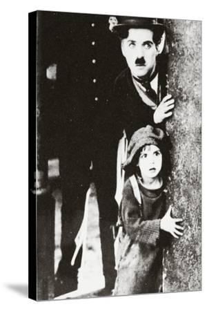 Charlie Chaplin and Jackie Coogan in 'The Kid', 1920--Stretched Canvas Print