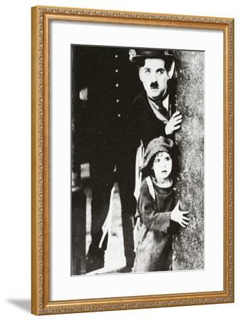 Charlie Chaplin and Jackie Coogan in 'The Kid', 1920--Framed Photographic Print