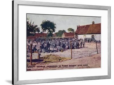 Thirsty German Prisoners in their Barbed Wire Cage, World War I--Framed Photographic Print