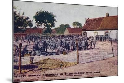 Thirsty German Prisoners in their Barbed Wire Cage, World War I--Mounted Photographic Print