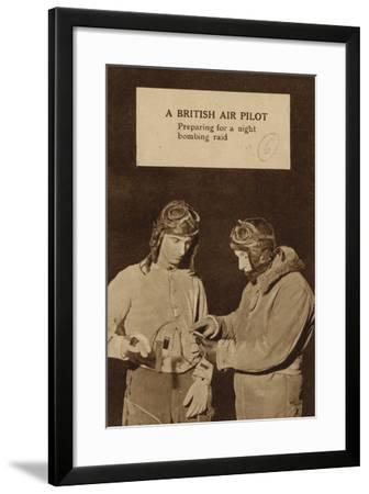 A British Air Pilot Preparing for a Night Bombing Raid, World War II--Framed Photographic Print