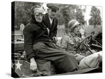 An Elderly Couple Sitting in a Jeep Driven by a Military Police--Stretched Canvas Print