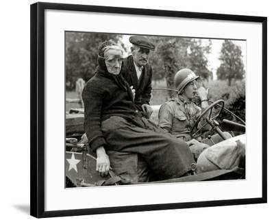 An Elderly Couple Sitting in a Jeep Driven by a Military Police--Framed Photographic Print
