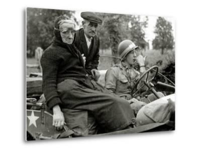 An Elderly Couple Sitting in a Jeep Driven by a Military Police--Metal Print
