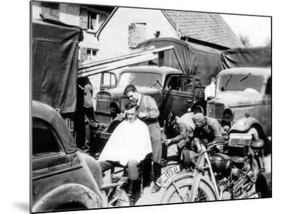 A German Soldier Is Getting a Haircut, France, 1940--Mounted Photographic Print