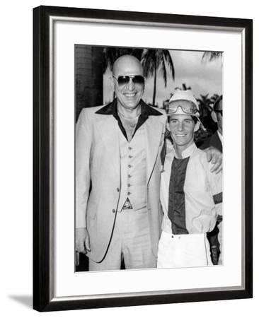 Actor Telly Savalas Poses with a Jockey at Hialeah Park, C.1970--Framed Photographic Print