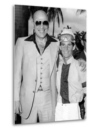Actor Telly Savalas Poses with a Jockey at Hialeah Park, C.1970--Metal Print