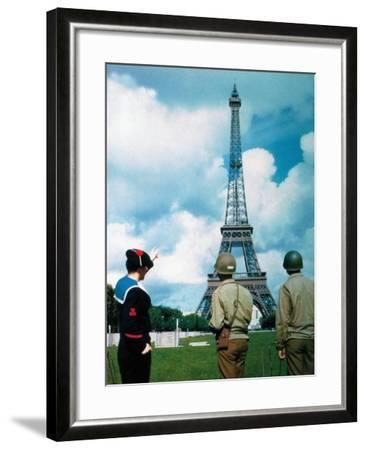 A French Sailor and Two Gis from Army Service Forces Looking at the Eiffel Tower--Framed Photographic Print