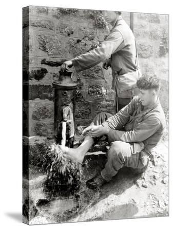 Private C. L. Scott of the 4th Infantry Division Is Washing His Feet at a Public Fountain--Stretched Canvas Print