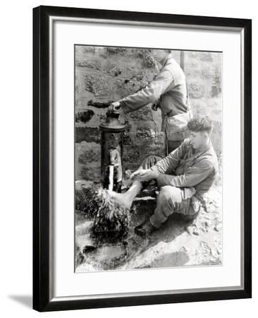 Private C. L. Scott of the 4th Infantry Division Is Washing His Feet at a Public Fountain--Framed Photographic Print