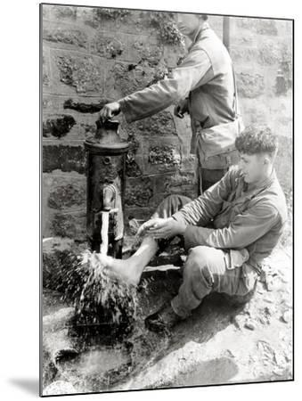Private C. L. Scott of the 4th Infantry Division Is Washing His Feet at a Public Fountain--Mounted Photographic Print