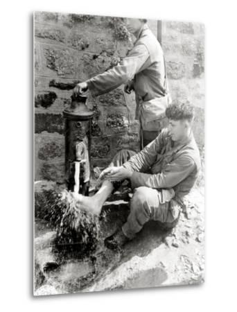 Private C. L. Scott of the 4th Infantry Division Is Washing His Feet at a Public Fountain--Metal Print