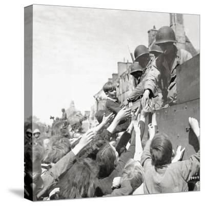 Women and Children Greeting Gis on a Half Track M3A1 Which Is Behind a M4 Sherman Tank--Stretched Canvas Print