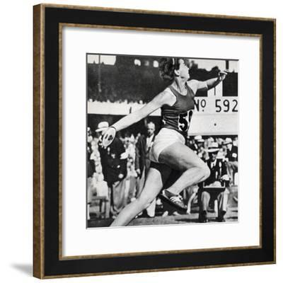 Olga Fikotova of Czechoslovakia Setting a New Olympic Record in the Final of the Women's Discus--Framed Photographic Print