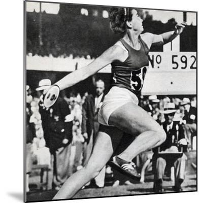 Olga Fikotova of Czechoslovakia Setting a New Olympic Record in the Final of the Women's Discus--Mounted Photographic Print