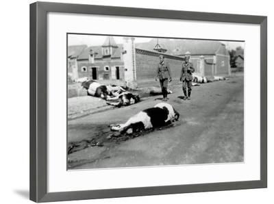 Two German Soldiers Among a Herd of Dead Cows in Front of a Farm--Framed Photographic Print