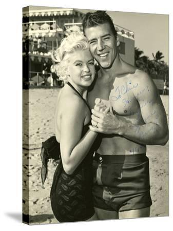 Actress Jayne Mansfield and Her Husband Mickey Hargitay Embracing on Miami Beach, 1958.--Stretched Canvas Print