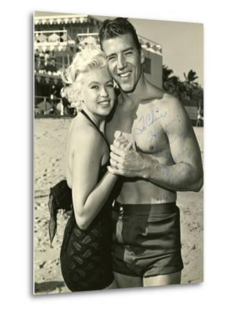 Actress Jayne Mansfield and Her Husband Mickey Hargitay Embracing on Miami Beach, 1958.--Metal Print
