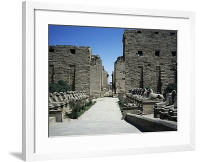The Entrance with the First Pylon and Ram-Headed Sphinxes, Temple of Amun, Karnak Temple Complex--Framed Photographic Print