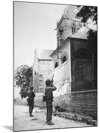 Us Paratrooper Fires into Church Steeple at Sainte Mere Eglise to Clear Enemy Sniper, 6th June 1944--Mounted Photographic Print