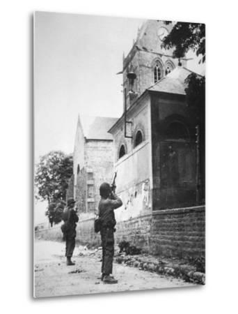 Us Paratrooper Fires into Church Steeple at Sainte Mere Eglise to Clear Enemy Sniper, 6th June 1944--Metal Print