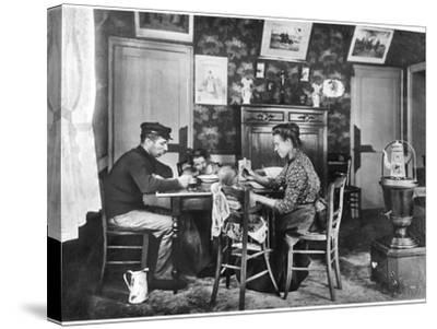 Family around a Table, from a Photo Album on Housing Development in Lens, 1906--Stretched Canvas Print