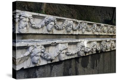 Marble Frieze with Male Heads and Fruit Garlands--Stretched Canvas Print