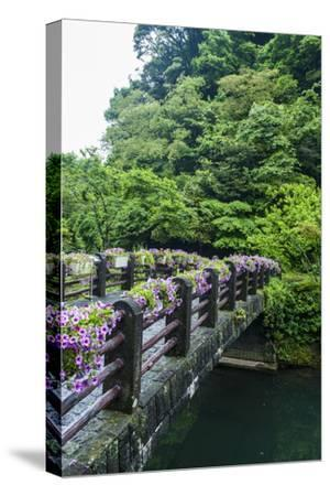 Stone Bridge with Flowers in Seogwipo-Michael-Stretched Canvas Print