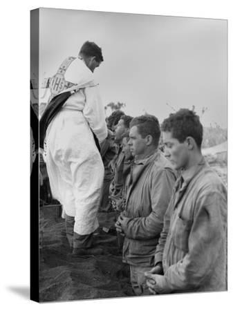 U.S. Marines and a Chaplain Celebrate Catholic Communion During the Battle of Iwo Jima--Stretched Canvas Print