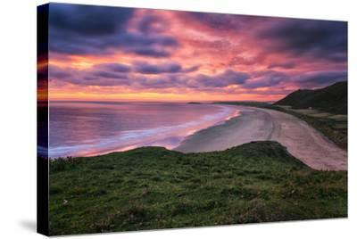 Colorful Sunset over the Beach in Rhossili on the Gower Peninsula, Wales, United Kingdom-Frances Gallogly-Stretched Canvas Print