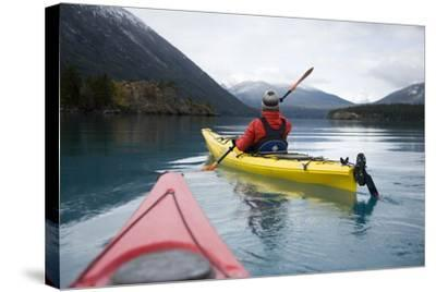 Young Woman Kayaking on Chilko Lake in British Columbia, Canada-Justin Bailie-Stretched Canvas Print