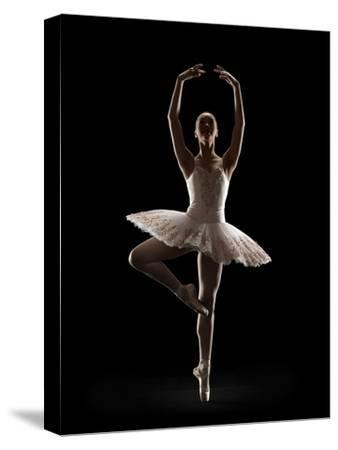 Ballerina in Releve Pose-Lewis Mulatero-Stretched Canvas Print
