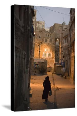 Woman Walking in Old Town, Dusk, San'a, Yemen, Middle East-Holger Leue-Stretched Canvas Print