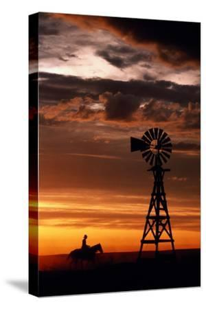 Man on Horse, Riding past Wind Turbine, Silhouetted at Sunset-Kathi Lamm-Stretched Canvas Print