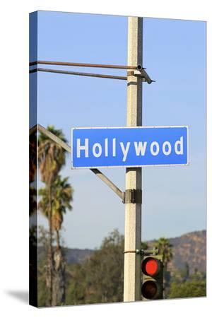 Close-Up of a Blue Street Sign on a Lamppost for Hollywood.-Thinkstock-Stretched Canvas Print