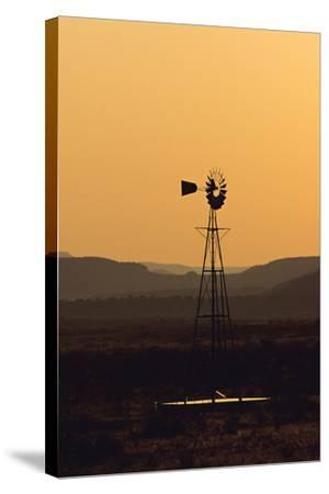 A Desert Windmill at Sunset-Wesley Hitt-Stretched Canvas Print