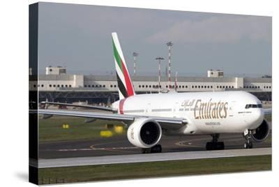 An Emirates Boeing 777 at Milano Malpensa Airport, Italy--Stretched Canvas Print