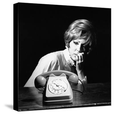 A Woman Looking at a Phone-Marisa Rastellini-Stretched Canvas Print
