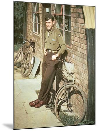 A United States Air Force Pilot Standing in Front of His Quarters, England, United Kingdom, 1944--Mounted Photographic Print